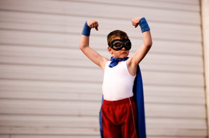 Confident boy raising arms in the air